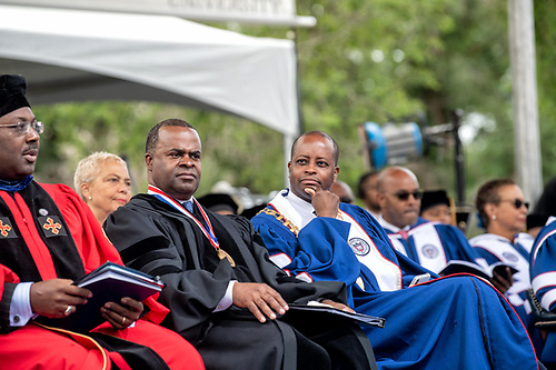 Provost Anthony Wutoh, Kasim Reed, and President Wayne A.I. Frederick seated onstage at Commencement.
