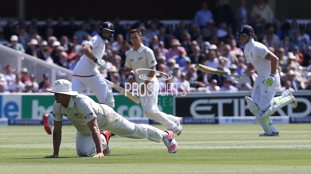 New Zealand fiielder just misses runs from England Joe Root during the first day of the Investec 1st Test  match between England and New Zealand at Lord's Cricket Ground, St John's Wood, United Kingdom on 21 May 2015. Photo by Ellie  Hoad.