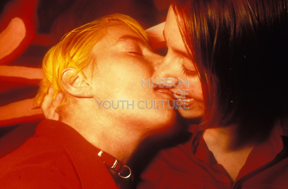 Clubbing couple passionately kissing, Ibiza 1999