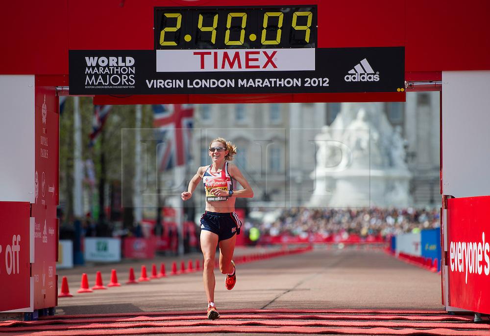 © London News Pictures. 22/04/2012. London, UK. Liz Yelling of Great Britain celebrates finishing the Virgin London Marathon 2012 on April 22, 2012 in London, England. Photo credit : Ben Cawthra /LNP