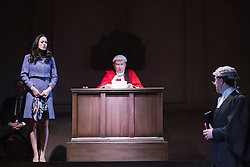 "© Licensed to London News Pictures. 01/11/2013. London, England. Pictured. Sarah Armstrong as Christine Keeler in the dock with Andrew Harrison as Lord Astor. The play ""Keeler"", the inside story of the Profumo Affair based on the book ""The Truth at Last"" by Christine Keeler opens at the Charing Cross Theatre with Sarah Armstrong as Christine Keeler and Paul Nicholas as Stephen Ward. The play is scheduled to run from 31 October to 14 December 2013. Photo credit: Bettina Strenske/LNP"
