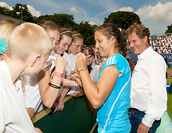 LIVERPOOL, ENGLAND - Tuesday, June 16, 2009: Laura Robson (GBR) signs autographs for fans after playing an exhibition match in front of 3,000 school children during a kids day at the Tradition ICAP Liverpool International Tennis Tournament 2009 at Calderstones Park.  Also Tournament Director Anders Borg. (Pic by David Rawcliffe/Propaganda)