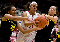 February 18, 2010; Stanford, CA, USA;  Stanford Cardinal guard Rosalyn Gold-Onwude (21) battles with Oregon Ducks forward Jasmin Holliday (30) and guard Taylor Lilley (1) for a loose ball during the first half at Maples Pavilion.  Stanford defeated Oregon 104-60.