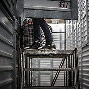 WASHINGTON, DC-OCT14: A homeless woman in her  storage unit at Capital Self-Storage, October 14, 2015, in Washington, DC. Many of the area homeless have possessions they want to keep safe, just nowhere permanent to live, so they store their belongings at Capital Self-Storage, where an upper-level unit costs $30/month. Some of the homeless patrons also spend their days in their storage units, when shelters are closed during midday hours. The storage facility near 3rd and Florida Avenue in Northeast, Washington, DC, is about to be replaced by a boutique hotel. (Photo by Evelyn Hockstein/For The Washington Post)