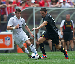 BALTIMORE, MD - Saturday, July 28, 2012: Liverpool's Stewart Downing in action against Tottenham Hotspur's Gareth Bale during a pre-season friendly match at the M&T Bank Stadium. (Pic by David Rawcliffe/Propaganda)