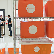 OCTOBER 6, 2017--PONCE, PUERTO RICO ---<br /> Allan Cintron Salichs, left, Executive Director of Med Centro in Ponce, and Direct Relief's Gordon Willcock and Damon Taugher in a storage space with donated medical relief packages given to Med Centro following the path of Hurricane Maria through Puerto Rico.<br /> (Photo by Angel Valentin/Freelance)