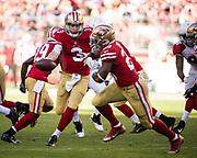 San Francisco 49ers quarterback C.J. Beathard (3) hands the ball off to San Francisco 49ers running back Carlos Hyde (28) against the Arizona Cardinals at Levi's Stadium in Santa Clara, Calif., on November 5, 2017. (Stan Olszewski/Special to S.F. Examiner)
