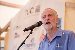 © Licensed to London News Pictures.  22/07/2018; Tolpuddle, Dorset, UK. JEREMY CORBYN, leader of the Labour Party, speaks at the Tolpuddle Martyrs Festival. The Tolpuddle Martyrs Festival for trade unionism, held every year, commemorates the birth of the trade union movement in the 19th century when the Tolpuddle Martyrs were transported to Australia for forming a trade union of agricultural labourers in Dorset. This year is also the 150th anniversary of the TUC. Photo credit: Simon Chapman/LNP