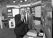 The 1989 Boat Show.   (R89)..1989..10.03.1989..03.10.1989..10th March 1989..Pat the Cope GallagherTD, Minister for the Marine attended the opening of the 1989 Boat Show held at the Point Depot, Dublin. The opening coincided with the minister's birthday...Image shows the Minister Pat the Cope Gallagher at the coastguard stand,trying out their radio system, at the Boat Show in the Point Depot.