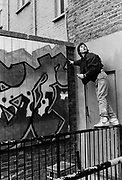 Tim, a graffiti artist at work, UK, 1987