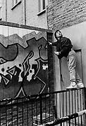 Tim, a graffiti artist at work, UK, 1987