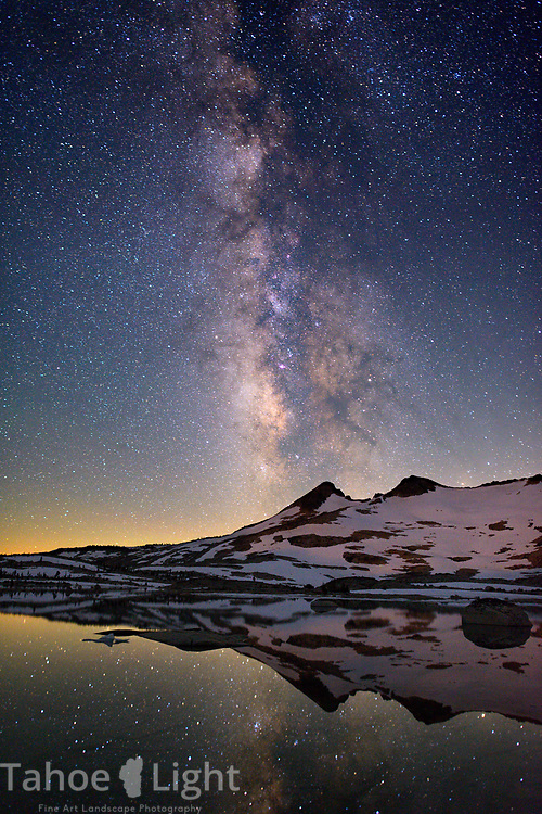 Milky Way over Pyramid peak and reflection of Lake Aloha in the Desolation wilderness area in south lake tahoe.