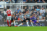 Martin Dubravka (#12) of Newcastle United dives but fails to stop the shot from Mesut Ozil (#10) of Arsenal who scores Arsenal's second goal (0-2) during the Premier League match between Newcastle United and Arsenal at St. James's Park, Newcastle, England on 15 September 2018.