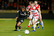 Barnsley forward Victor Adeboyejo (29) goes past Paul Downing of Doncaster Rovers  during the EFL Sky Bet League 1 match between Doncaster Rovers and Barnsley at the Keepmoat Stadium, Doncaster, England on 15 March 2019.
