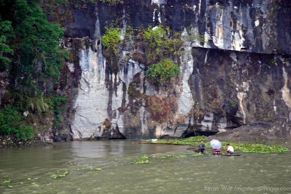 Asia, China, Guangxi, Guilin, Li River. Locals rafting amongst the greenery of the Li JIang river.