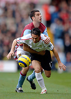 Photo: Glyn Thomas.<br />Aston Villa v Liverpool. The Barclays Premiership. <br />05/11/2005.<br />Fernando Morientes (R) is held back by Villa's Mark Delaney.