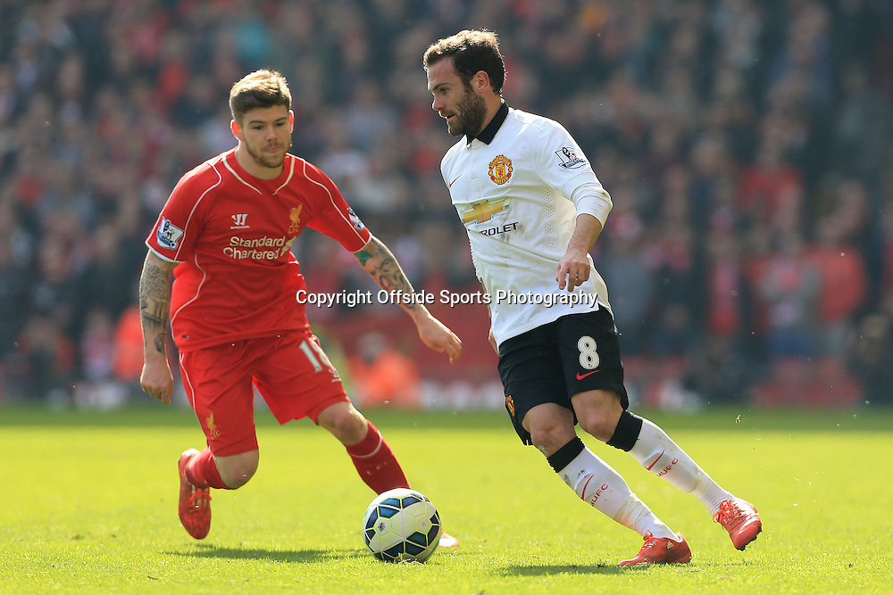 22nd March 2015 - Barclays Premier League - Liverpool v Manchester United - Juan Mata of Man Utd battles with Alberto Moreno of Liverpool - Photo: Simon Stacpoole / Offside.