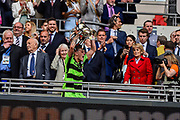 Forest Green Rovers Charlie Cooper(20) lifts the play off final trophy during the Vanarama National League Play Off Final match between Tranmere Rovers and Forest Green Rovers at Wembley Stadium, London, England on 14 May 2017. Photo by Adam Rivers.