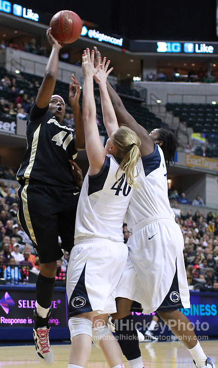 March 03, 2012; Indianapolis, IN, USA; Purdue Boilermakers forward Alex Guyton (41) shoots the ball over Penn State Lady Lions forward Marisa Wolfe (40) during the semifinals of the 2012 Big Ten Tournament at Bankers Life Fieldhouse. Mandatory credit: Michael Hickey-US PRESSWIRE