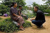FACTS reporter Bals Rigendinger speaks with Julia Set, left, and her mother at their home in a small town near San Juan Sacatepéquez, Guatemala. Julia Set, a 20-year-old Mayan woman who lives in a small town near San Juan Sacatepéquez, Guatemala, says she sold her baby in 2003 for 400 Quetzales (about U.S. $52) to a woman introduced to her by a midwife. Her baby and 8 others were found the next month in a Costa Rican house run by an unregistered adoption agency.