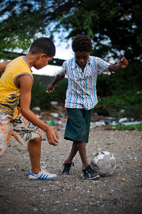 Boys shout in Papiamentu while playing soccer in Paraiso, a slum in Willemstad, Curaçao. Officials confirm that the vast  majority of local Curaçaoans speak Papiamentu in their homes. In 2007 the government recognized Papiamentu as the official language in Curaçao, along with Dutch and English.