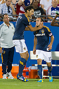 FRISCO, TX - AUGUST 11:  Landon Donovan #10 of the Los Angeles Galaxy celebrates after his third goal of the game against FC Dallas on August 11, 2013 at FC Dallas Stadium in Frisco, Texas.  (Photo by Cooper Neill/Getty Images) *** Local Caption *** Landon Donovan