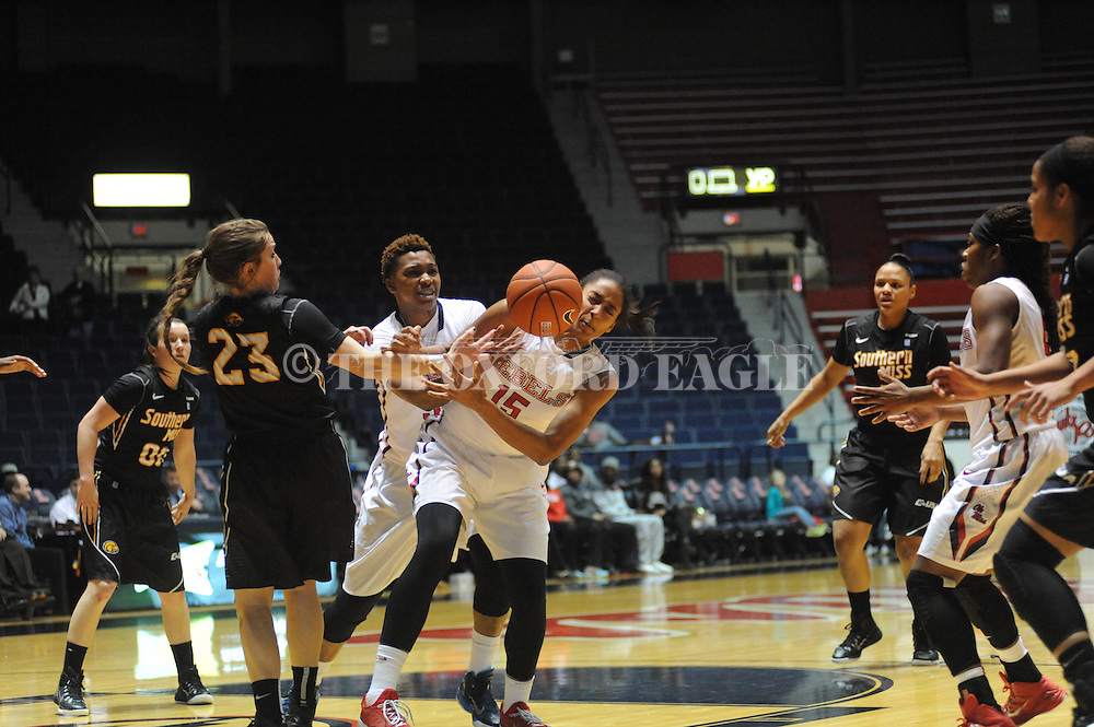 "Ole Miss Lady Rebels forward Tia Faleru (32) and Ole Miss Lady Rebels forward Kelsey Briggs (15) vs. Southern Mississippi Lady Golden Eagles guard Brooke Rhodes (23) at the C.M. ""Tad"" Smith Coliseum in Oxford, Miss. on Thursday, December 18, 2014. (AP Photo/Oxford Eagle, Bruce Newman)"