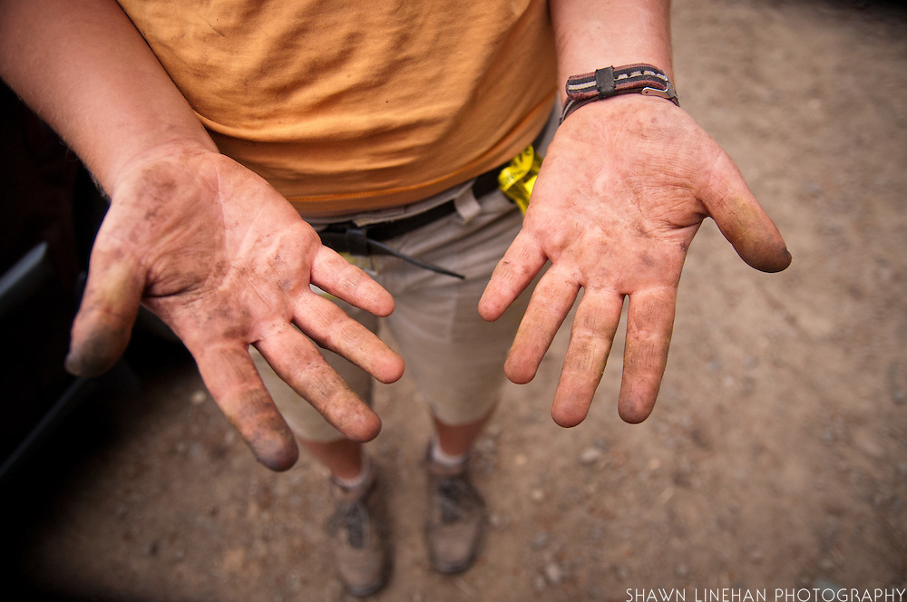 Farm worker's dirt-covered hands.