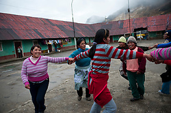 A group of women rehearse the dance routine they will perform during the celebrations of the 104th anniversary of Morococha.