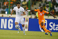 Saphir Taider (L) of Algeria shields the ball against Serey Die  of Ivory Coast during their AFCON 2015 Quarter Finals Match on February 1 2015 at Estadio de Malabo Equatorial Guinea. Photo/Mohammed Amin/www.pic-centre.com (Equatorial Guinea)