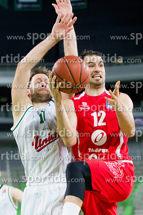 Sasa Zagorac #17 of KK Union Olimpija and Sandi Cebular #12 of KK Tajfun during basketball match between KK Union Olimpija Ljubljana and KK Tajfun in 22th Round of ABA League 2015/16, on January 30, 2016 in Arena Stozice, Ljubljana, Slovenia. Photo by Urban Urbanc / Sportida