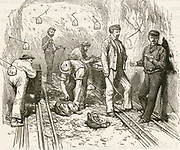 'Frejus Rail Tunnel (Mont Cenis Tunnel) 1857-1871 in the Alps linking France and Ital. Clearing debris  after blasting charges placed in holes drilled by Sommeiller's machine.  Engraving, Pa\ris, 1874.'