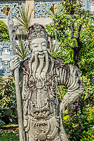stone chinese guardian statue at Wat Pho temple Bangkok Thailand