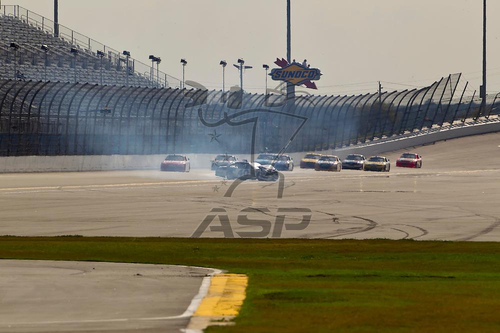Daytona Beach, FL - Feb 23, 2012: Michael Waltrip (40) spins off of turn 2 and wrecks during the Gatorade Duel 1 race at the Daytona International Speedway in Daytona Beach, FL.