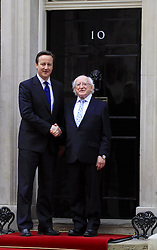 Irish President Higgins meets PM at Downing Street. The President of Ireland Michael D Higgins meets David Cameron in an historic first state visit to UK. 10 Downing Street, London, United Kingdom. Wednesday, 9th April 2014. Picture by Mike Webster / i-Images