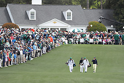April 8, 2018 - Augusta, GA, USA - Jordan Spieth, left, and Justin Thomas head down the fairway after their tee shots on one during the final round of the Masters at Augusta National Golf Club on Sunday, April 8, 2018, in Augusta, Ga. (Credit Image: © Curtis Compton/TNS via ZUMA Wire)