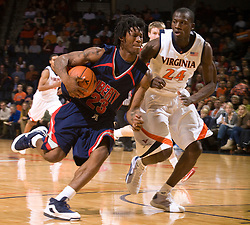 Liberty guard Brolin Floyd (23) is guarded by Virginia guard/forward Mamadi Diane (24).  The Virginia Cavaliers fell to the Liberty Flames 86-82 in NCAA Division 1 men's basketball at the University of Virginia's John Paul Jones Arena  in Charlottesville, VA on March 9, 2008.