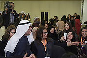 Kuwaiti MP Ahmad Al-Sadoun, a veteran politician and three-time former Speaker of Parliament, laughs as he talks with a group of women attending a nighttime rally in Kuwait City on Jan. 18 to inaugurate his elections HQ.  Al-Sadoun is among some 340 candidates who are running in the Feb. 2, 2012 polls to elect a new 50-seat National Assembly (parliament).