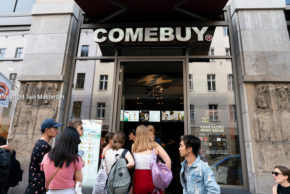 Queue of customers outside Korean cafe Comebuy in Mitte, Berlin, Germany