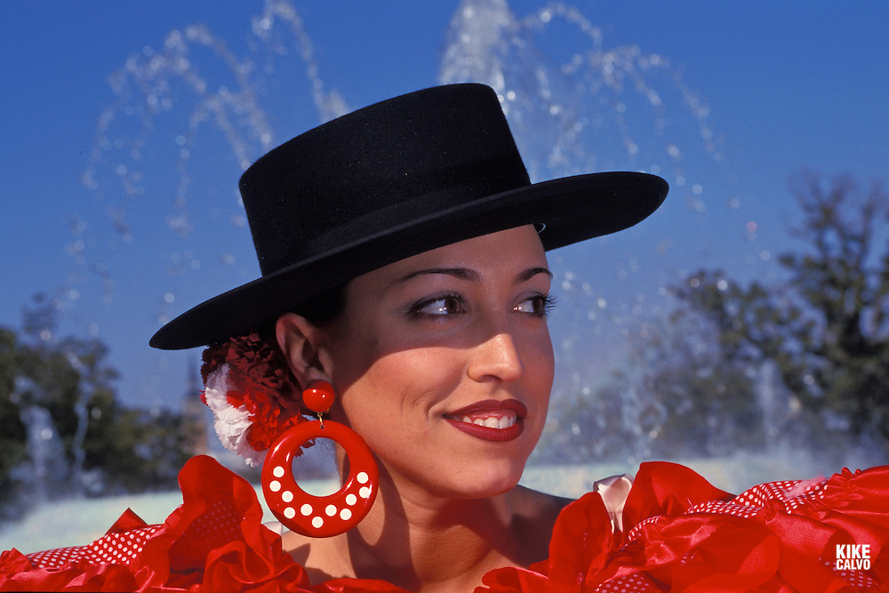 Seville, Spain. Model released photo of a Andalusian woman dress in the typical Sevillanas dress
