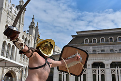 © Licensed to London News Pictures. 26/08/2017. London, UK. A member of the Brittania re-enactment group dressed as a gladiator joins others in Gladitorial Games in Guildhall Yard, the site of London's only Roman Amphitheatre.  The Gladiator Games will be entertaining crowds over the August Bank Holiday Weekend. Photo credit : Stephen Chung/LNP
