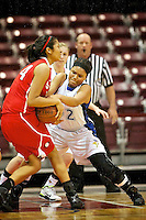 Coeur d'Alene High's Kendalyn Brainard fights for the ball with Jacqueline Luna-Castro from Boise High.