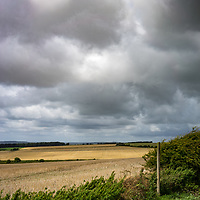 View across farmland from the top of the Sussex Downs near Storrington