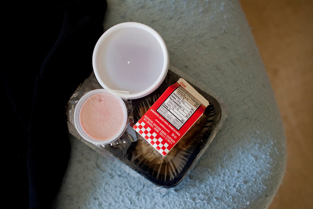 A lunch rests on Gerald Grubb's bed after it was delivered by Horizons volunteer coordinator Anna Ronnebaum in Cedar Rapids, Iowa on Thursday, November 19, 2015. Each meal costs an estimated $7.20, of which $4.34 is reimbursed by the federal government through the Older Americans Act of 1965, which was enacted to support seniors' health and independence. (Rebecca F. Miller/Freelance for The Gazette)