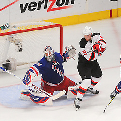 May 14, 2012: New York Rangers goalie Henrik Lundqvist (30) and New Jersey Devils right wing Dainius Zubrus (8) watch a puck fly wide of the net during third period action in game 1 of the NHL Eastern Conference Finals between the New Jersey Devils and New York Rangers at Madison Square Garden in New York, N.Y. The Rangers defeated the Devils 3-0.