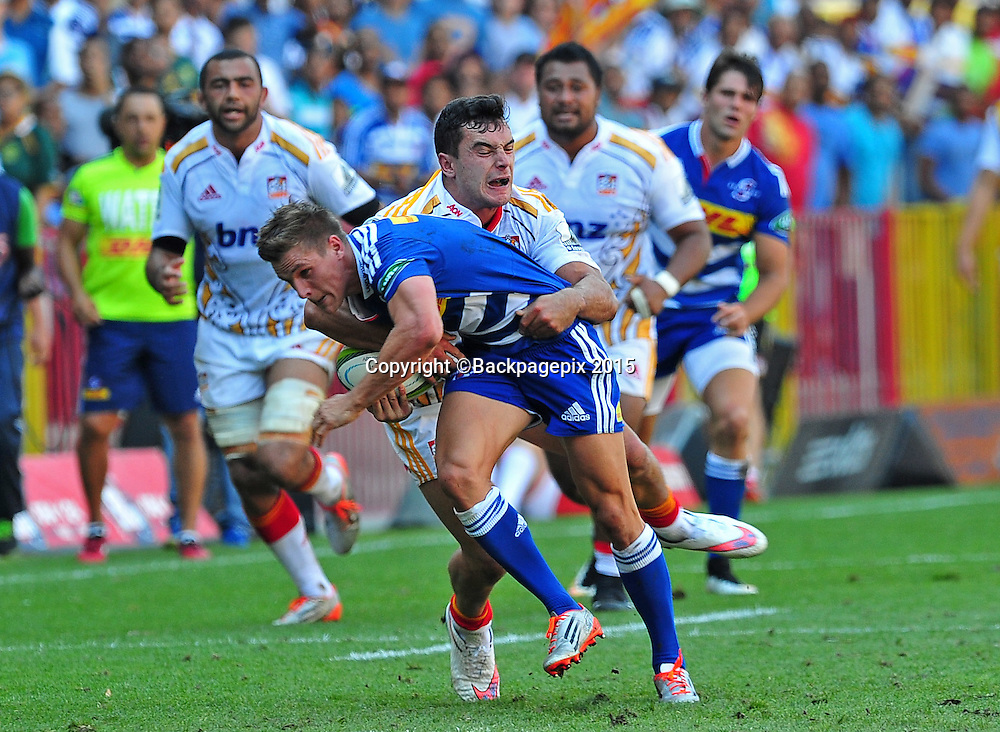 Louis Schreuder of the Stormers is tackled by James Lowe of the Chiefs during the 2015 Super Rugby game between the Stormers and the Chiefs at Newlands Stadium, Cape Town on 14 March 2015 ©Ryan Wilkisky/BackpagePix