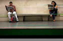Man and women reading newspaper while waiting a train at the underground station. (Photo by Vid Ponikvar / Sportal Images)