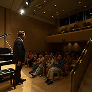 June 11, 2012 - New York, NY :  Austrian pianist and composer Philipp Schneider-Siemssen acknowledges the audience's applause after performing for a packed house at the Austrian Cultural Forum in midtown Manhattan on Monday night. CREDIT: Karsten Moran for The New York Times