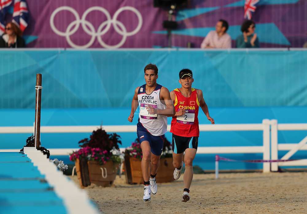 David Svoboda of the Czech Republic and Zhongrong Cao of China compete during the running portion of the men's modern pentathlon during day 15 of the London Olympic Games in London, England, United Kingdom on August 11, 2012..(Jed Jacobsohn/for The New York Times)..
