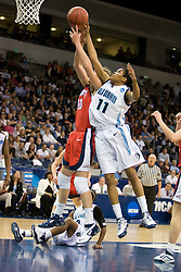 Old Dominion forward Shahida Williams (11) goes up to block a shot by Liberty guard/forward Megan Frazee (40).  The #5 seed Old Dominion Lady Monarchs defeated the #12 seed Liberty Flames 82-62 in the first round of the 2008 NCAA Division 1 Women's Basketball Championship in Norfolk, VA on March 23, 2008